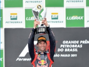 Mark Webbber lifting cup from Brazilian GP 2011